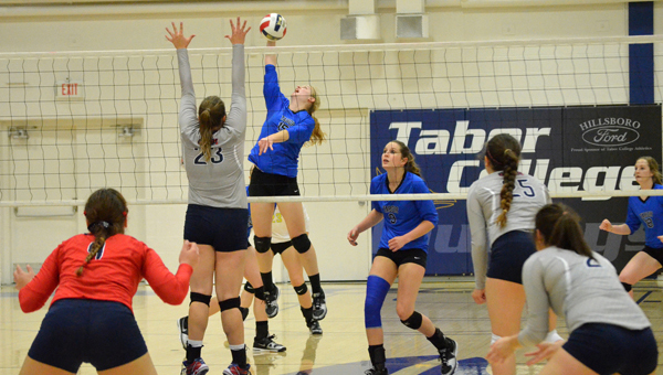 Janae Rempel / Free Press<p>Tena Loewen attacks the net as Oklahoma Wesleyan?s Krista Reimer blocks. Both are Hillsboro High School graduates. Tabor defeated the Eagles, 3-0, Friday. The Bluejays are the No. 4 seed in the KCAC tournament.