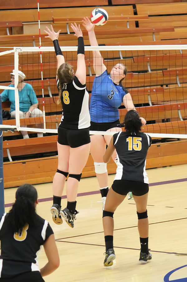 Brooke Halloway elevates for a kill against an Ottawa defender during the second set of Tabor's 3-1 win over the Braves for Ottawa's first loss in the KCAC.