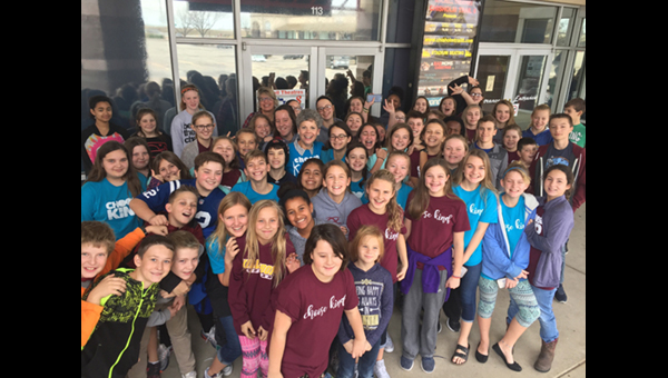 Hillsboro Middle School students gather for a group photo outside the Chisholm Trail movie theater in Newton during their Nov. 20 field trip. The HMS site council paid for the movie tickets and snacks to encourage the challenge to choose kindness at school and beyond.<p>