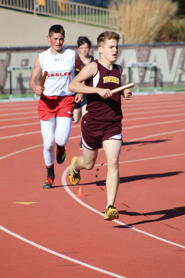 Hillsboro freshman Dillon Boldt heads down the straightaway to complete his leg of the Trojan 4x800 team. HHS finished fourth in 9 minutes, 10.47 seconds.