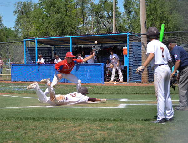 Hunter Hein slides home safely after a wild pitch in the top of the fourth inning versus Marion as Sam Zinn covers the plate.