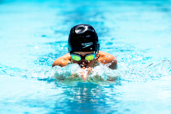 Frank Wichert swims the 100-yard IM. He placed second in the 13-14 year division. Karrie Rathbone