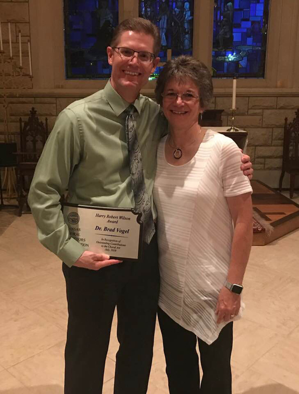 Bradley Vogel, pictured with wife Bev, holds the Harry Robert Wilson Award he received July 14 in Topeka for his leadership and involvement with the Kansas Choral Directors Association. Courtesy Photo