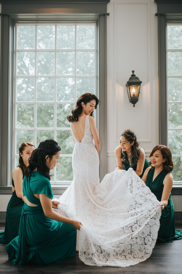 bride getting ready with bridesmaids gown