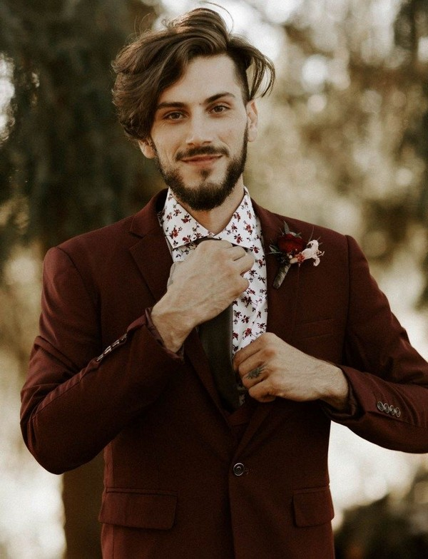 burgundy fall and winter groom wedding suit and burgundy boutonniere