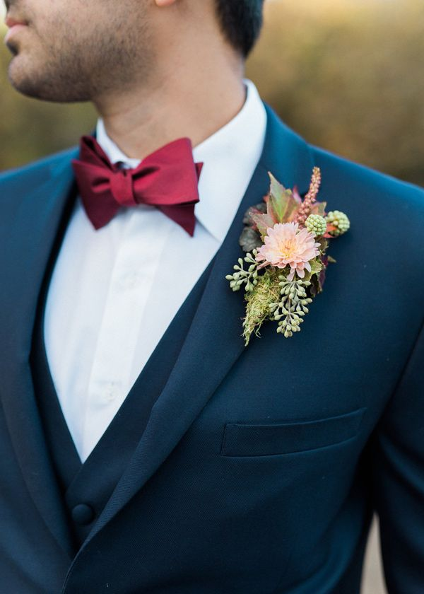 navy fall and winter groom wedding suit and peach boutonniere