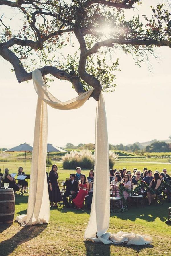 drapery on a tree wedding arch ideas