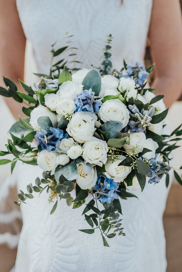 light blue and green eucalyptus and white roses wedding bouquet