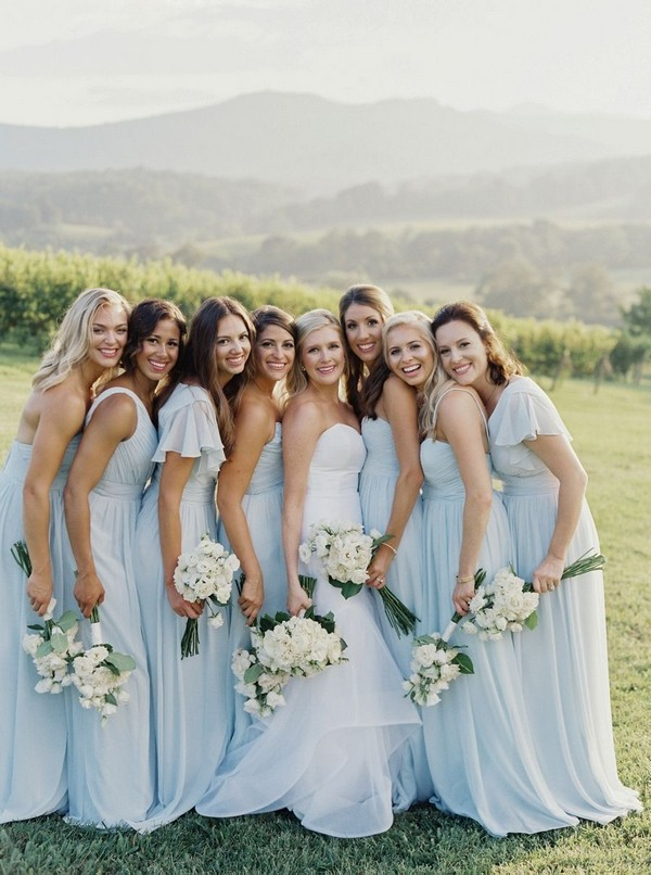 light blue mismatched bridesmaid dresses and green wedding bouquet
