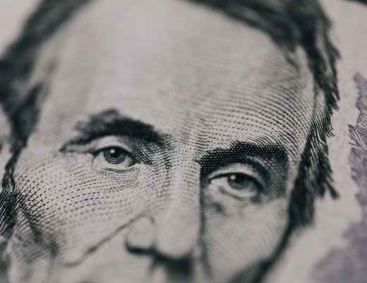 closeup of president printed on bill looking away
