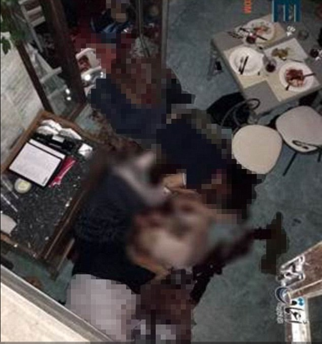 Gruesome: This is one of the images that was released by ISIS' media agency Amar, purportedly showing victims inside the Dhaka restaurant which was taken siege by Islamist militants on Friday night.