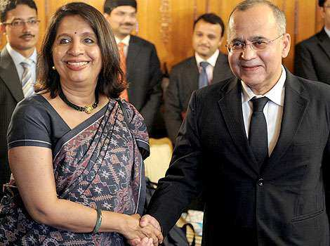 Indian foreign secretary Nirupama Rao (L) shakes hands with her Pakistani counterpart Salman Bashir prior to a meeting at The Pakistan foreign ministry in Islamabad. June 24: Day in pics