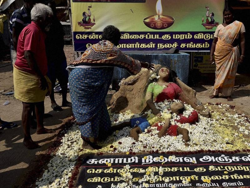 The fishermen community pay homage at a memorial of tsunami victims in Chennai. (PTI)