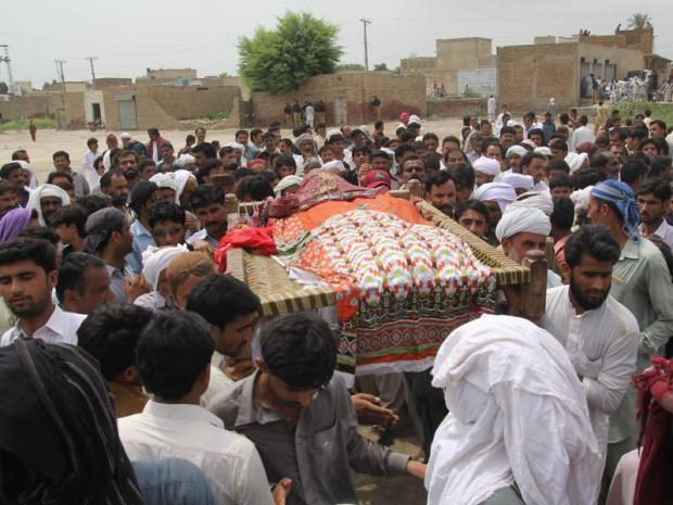People carry the coffin of social media celebrity Qandeel Baloch during her funeral in Shah Sadar Din village, around 130km from Multan in Pakistan. (AFP Photo)