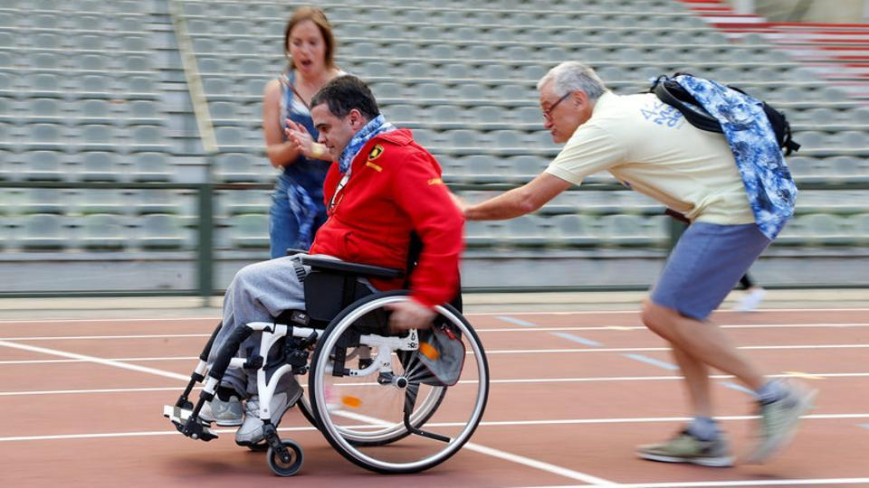 wheelchair olympics sports chair covers photos javelin throw race seniors take aim at a participant is pushed by an assistant as they part in the 4x25 metres relay