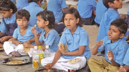 Children have mid-day meal at a government school in Jaipur.