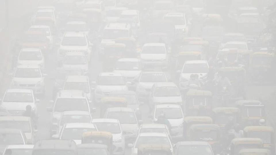 Vehicles drive through heavy smog in Delhi on November 8.