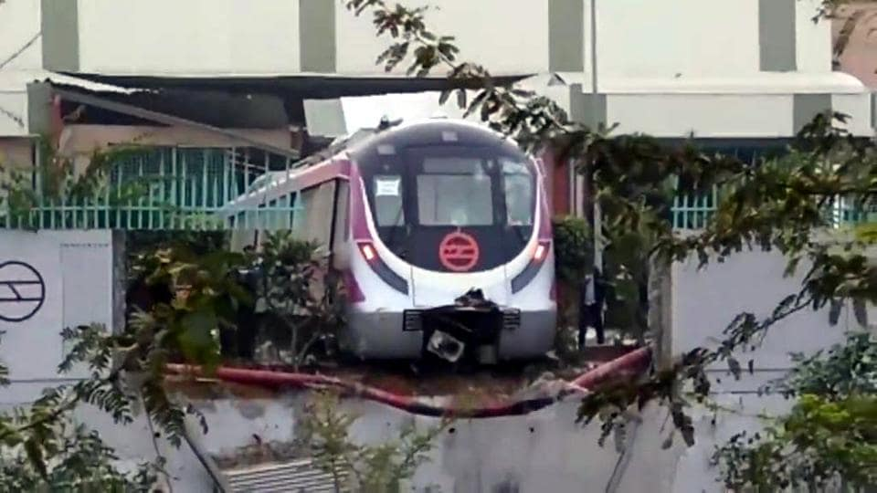 An empty Delhi Metro train broke through a boundary wall at the Kalindi Kunj station in New Delhi on December 19, 2017.