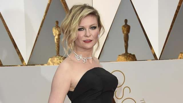 Kirsten Dunst arrives at the Oscars on February 26, 2017, at the Dolby Theatre in Los Angeles.