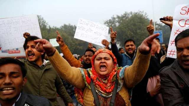 PressMirchi Demonstrators take part in a protest against a new citizenship law, in Delhi, on Thursday.
