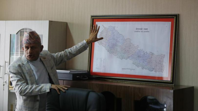 Nepal's foreign minister Pradeep Gyawali points to a map of Nepal in Kathmandu, Nepal.
