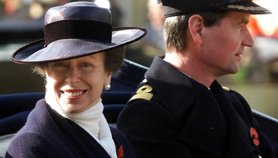 FILE - In this Nov. 6, 2001 file photo, Britain's Princess Anne with her husband Commander Tim Lawrence ride in a ceremonial carriage through Windsor town centre.