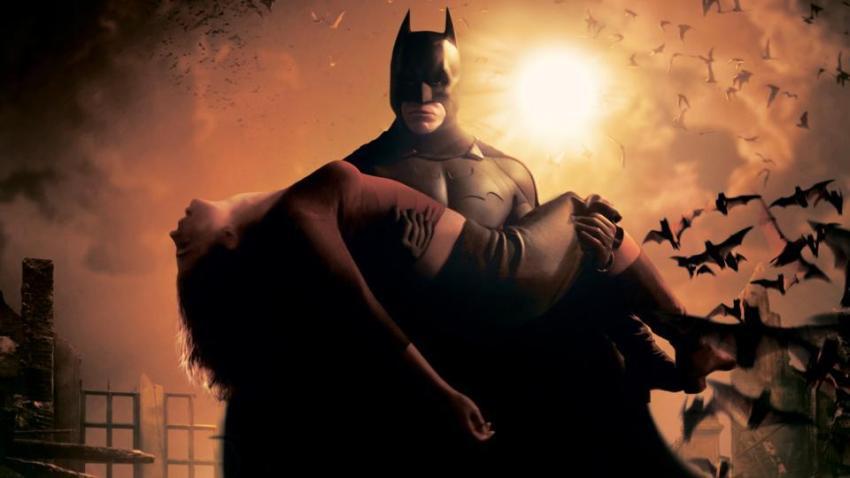 Christian Bale's Batman carries Katie Holmes' Rachel Dawes in Batman Begins