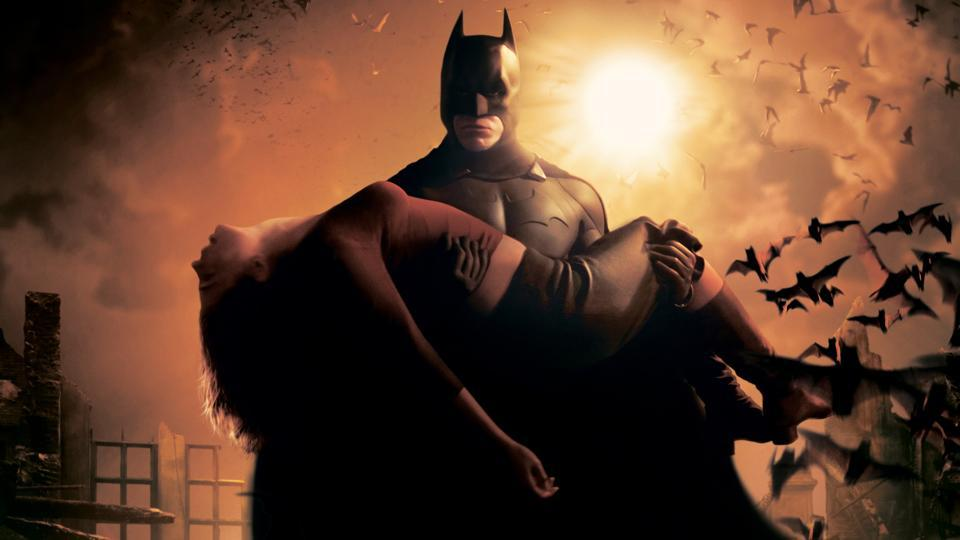 Christian Bale's Batman carries Katie Holmes' Rachel Dawes in Batman Begins