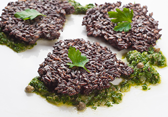 Hinode Rice: black rice fritters with chimichurri