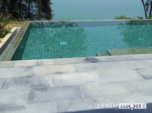 Green sukabumi sawn for pool tiles combine with sky blue for pool terrace