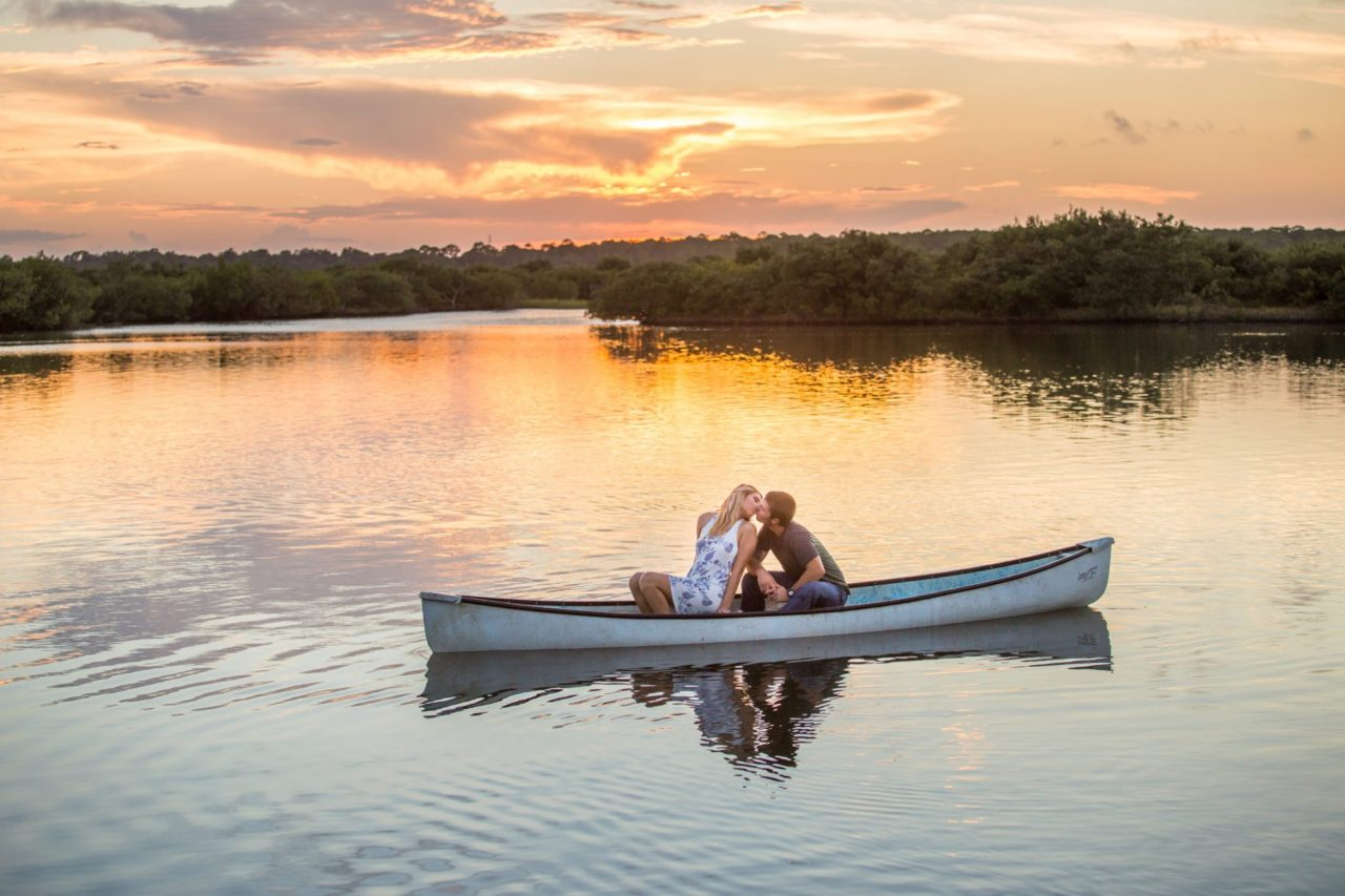 Canoe engagement photos, sunset engagement photos, new smyrna beach wedding photographer, ormond beach engagement photos