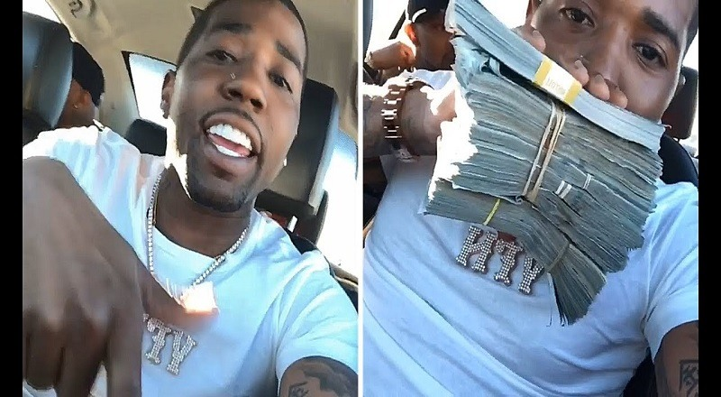 YFN Lucci flexes with piles of cash days before his debut