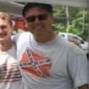 "Todd Bennett, a police officer, in Belleville, Ontario, in Canada, shared a photo of himself wearing a Confederate flag t-shirt. One of his friends commented, asking if he was wearing a treason t-shirt. He replied that he was wearing the ""real"" independence day flag, and ""The South will rise again,"" a George Wallace quote."
