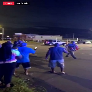 This evening, a video went viral of a young woman who was kicked out of an ice cream shop, after wrongfully being denied service. The cashier who refused to serve her called the police and said a fight was going to break out, leading to five officers arriving on the scene, and the eventual arrest of the woman, for trespassing. After the video went viral, people in Gastonia, North Carolina began protesting Tony's Ice Cream Shop, where the National Guard has now been called in, protecting the establishment, teargassing the protesters, all while a man marched down the street with a Confederate flag, running behind the Guard, when the protesters confronted him.