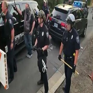In Springfield, Oregon, the police came, and they confronted the protesters. Footage of the altercation was shared by Cameron Ollivant to Facebook. The footage shows the police officers fighting the protesters, sending two men to the hospital, after breaking their noses.