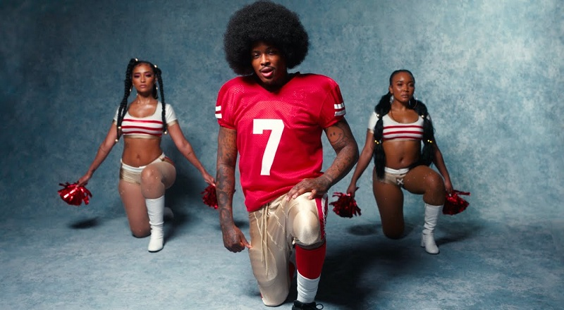 """YG releases """"Swag"""" music video, where he pays homage to Colin Kaepernick, rocking the afro, and taking the knee to kneel."""