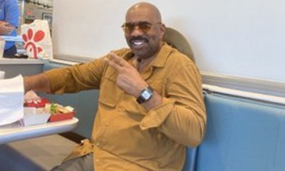 Steve Harvey was posted on Twitter, by Kanye West. The two were eating Chick-Fil-A, but that's not what people noticed. On Twitter, Steve Harvey is trending, because fans noticed the bulge between his legs, saying he's packing that loud.