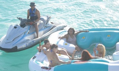 T.I. with women beside yacht