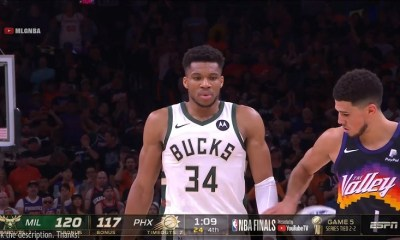 Devin Booker touches Giannis