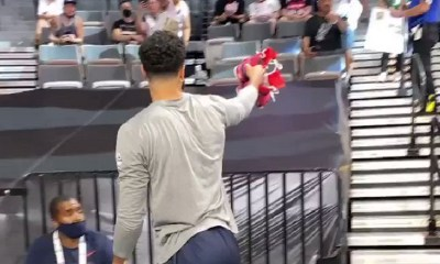 Jayson Tatum gives shoes to girl in the stands