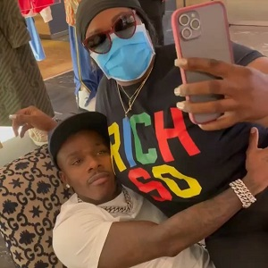 DaBaby has a female fan sitting on his lap