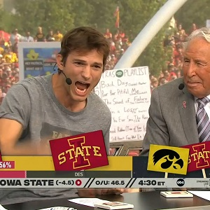 College football fans chant take a shower at Ashton Kutcher as he adds commentary during Iowa State game