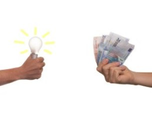 hands with money and light bulb