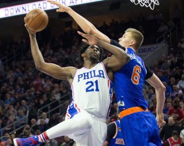 Jan 11, 2017; Philadelphia, PA, USA; Philadelphia 76ers center Joel Embiid (21) shoots against New York Knicks forward Kristaps Porzingis (6) during the second half at Wells Fargo Center. The Philadelphia 76ers won 98-97. Mandatory Credit: Bill Streicher-USA TODAY Sports