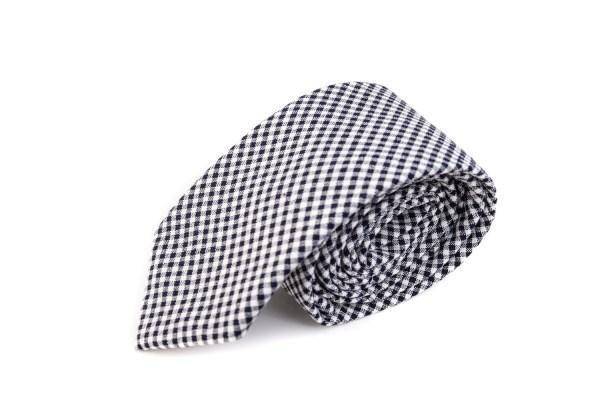 Geblokte stropdas met zwarte en witte blokjes.