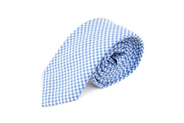 Geblokte stropdas met blauwe en witte blokjes.