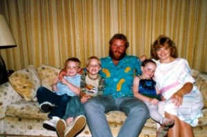 Brenna McKinnon as a child on grandparent's couch with parents and brothers
