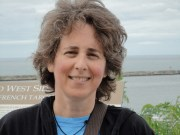 Donna Steiner with Lake Ontario behind her