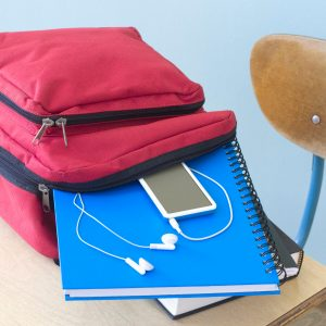 backpack with ipod and notebook falling out on desk