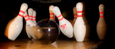 bowling ball knocking down four pins